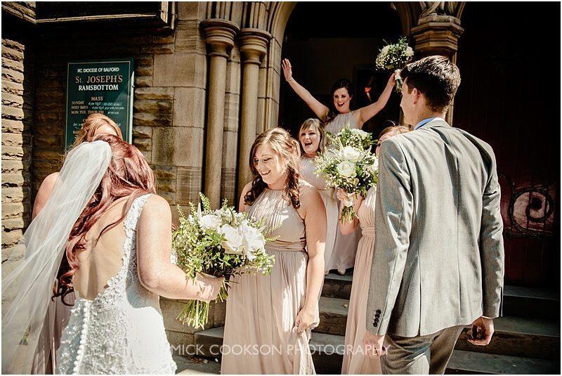bridesmaids congratulate the happy couple