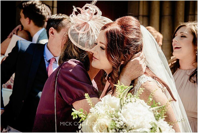 a kiss for the bride at a wedding