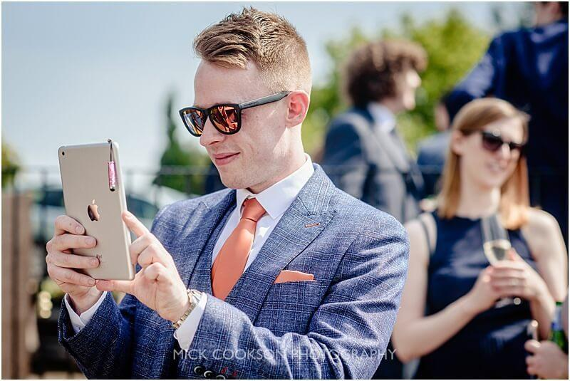 wedding guests with an ipad