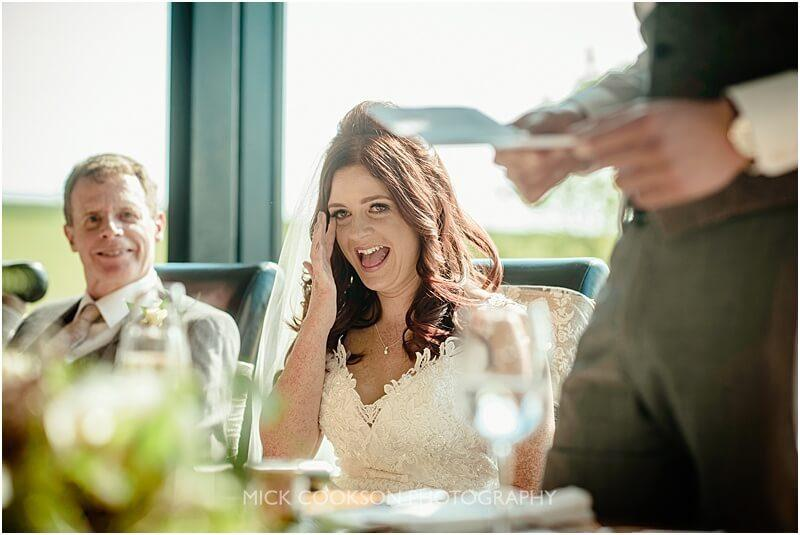 embarrassed bride dut=ring the speeches at the fishermans retreat