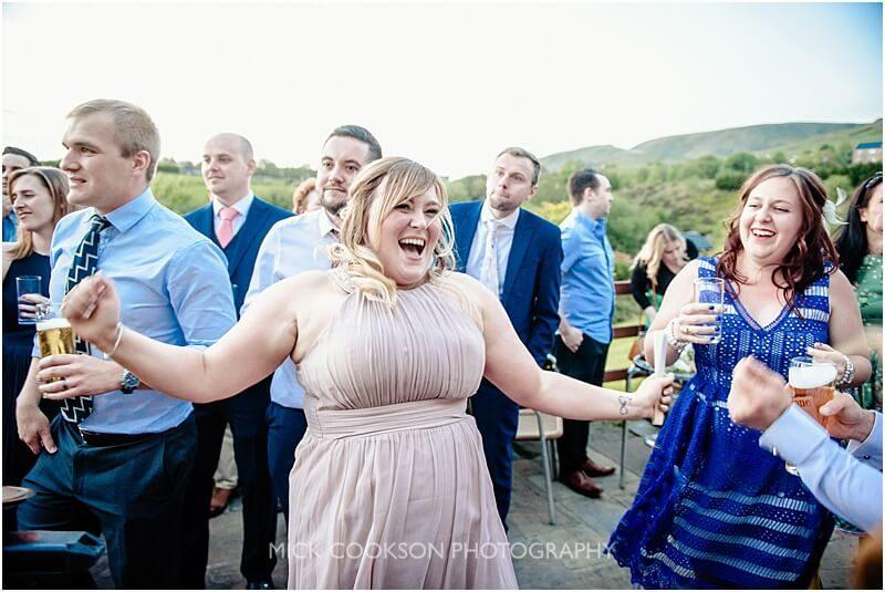 wedding guests dancing as mr wilsons second liners perform at the fishermans retreat by mick cookson photography