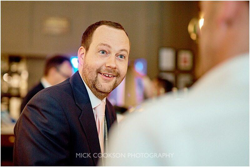 smiling groom at king street town house taken by manchester wedding photographer mick cookson