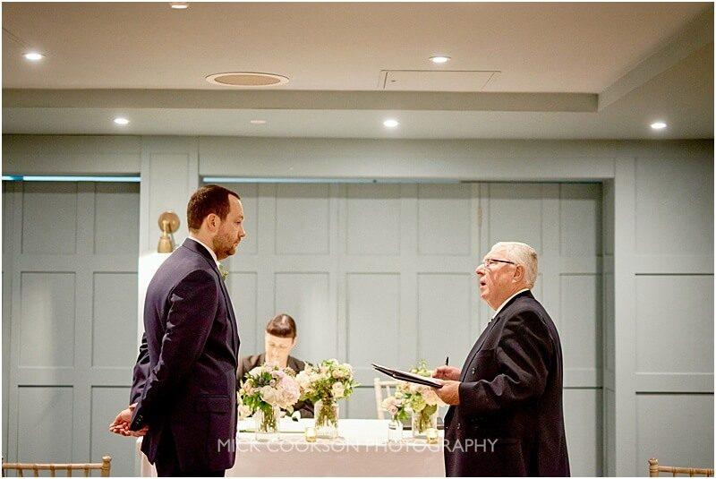 groom being interviewed by the registrar at king street town house