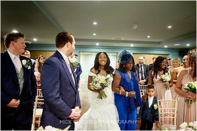 bride walks down the aisle at king street town house