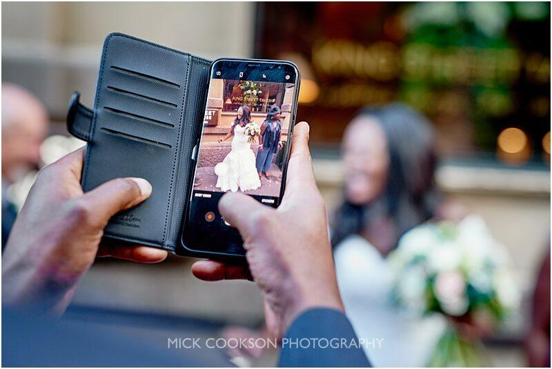 mobile phone wedding photo at king street town house