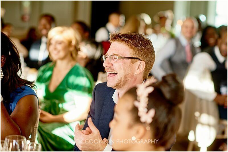 smiling wedding guest at a king street townhouse wedding taken by mick cookson