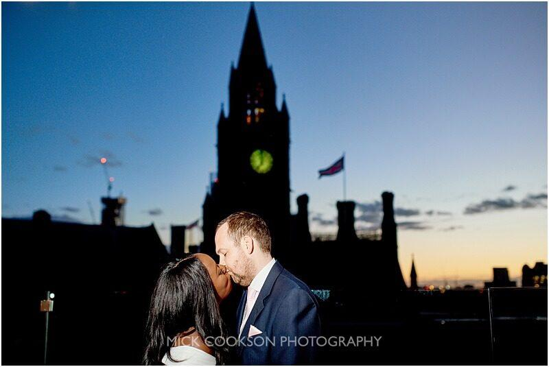 bride and groom wedding photo at night outside manchester town hall