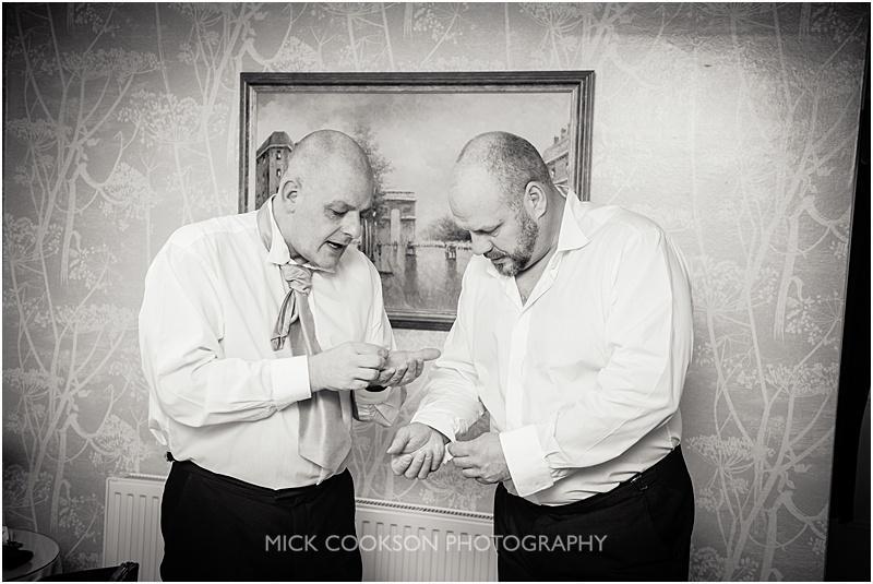 groom and best man getting ready at gibbon bridge wedding venue