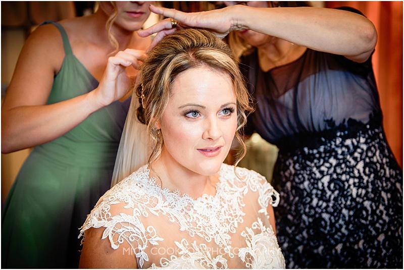 bride having her veil fitted at gibbon bridge wedding venue