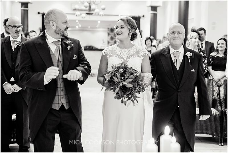 bride arrives at her gibbon bridge winter wedding