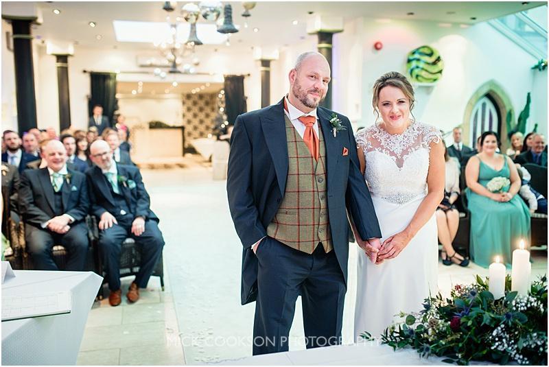 wedding ceremony at a gibbon bridge winter wedding