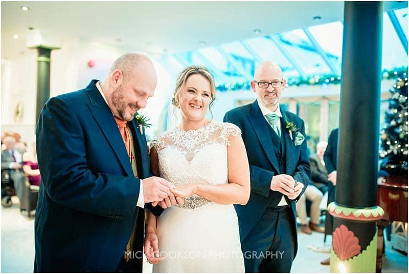 happy bride at her gibbon bridge winter wedding