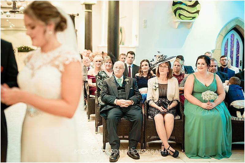 brides parents look on at a gibbon bridge winter wedding