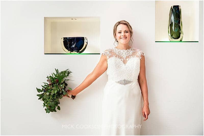happy bride at gibbon bridge by mick cookson