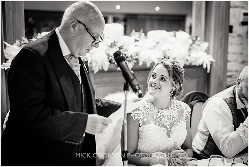 bride looks at her dad at a gibbon bridge winter wedding