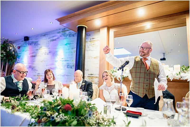 happy groom at a gibbon bridge winter wedding