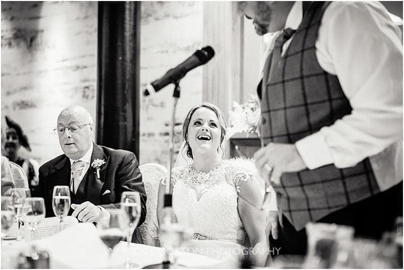 happy bride at a gibbon bridge winter wedding