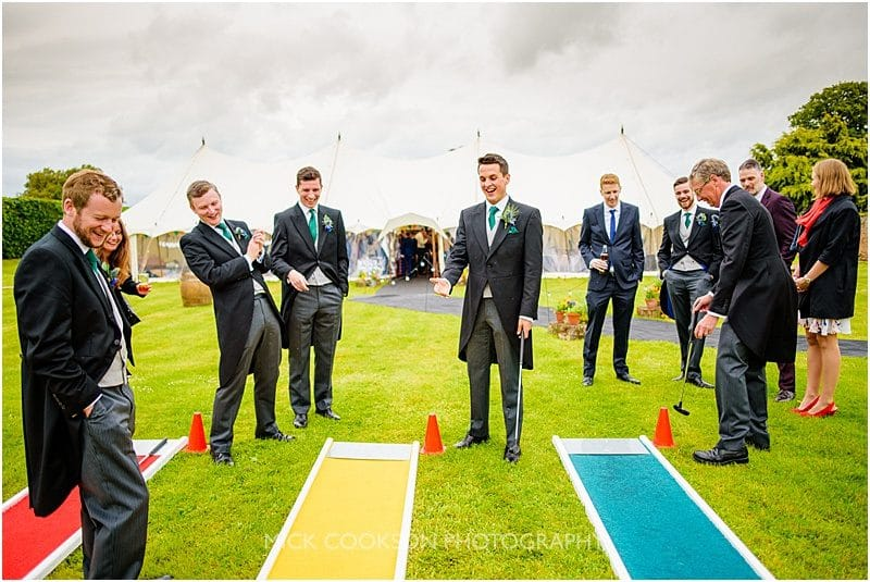 groomsmen playing crazy golf at a marquee wedding in york
