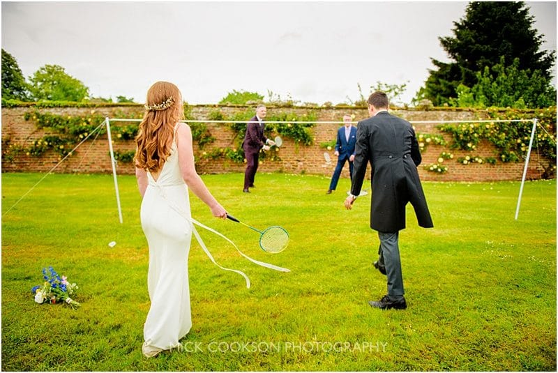 bride playing badminton at a marquee wedding in york