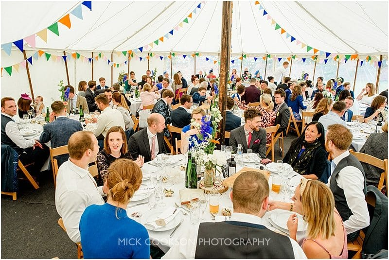 wedding guests seated at a marquee wedding in york
