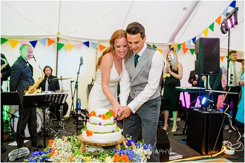 cake cutting at a marquee wedding in york